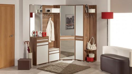 Идеальным вариантом для маленькой прихожей без сомнения является угловой комплект мебели