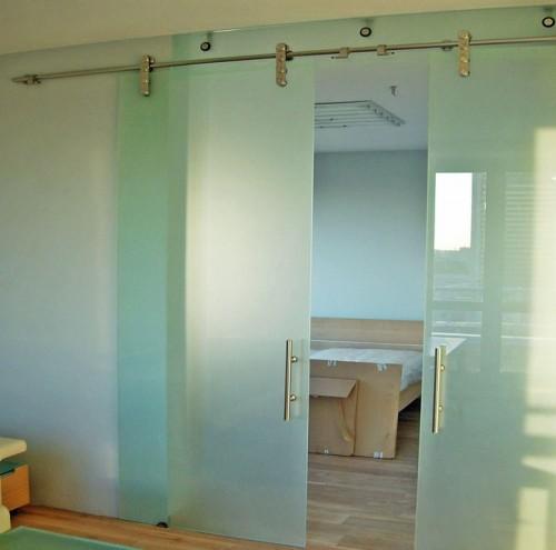Межкомнатные раздвижные двери из стекла